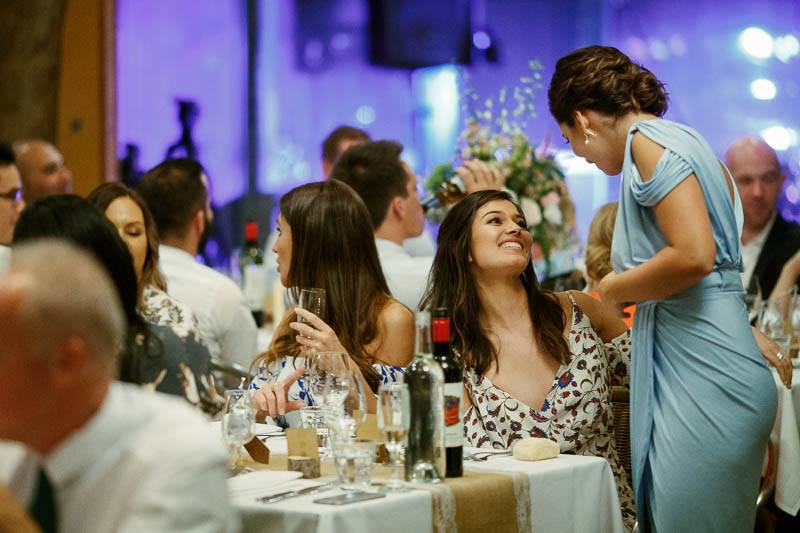 Guests chatting during the wedding reception