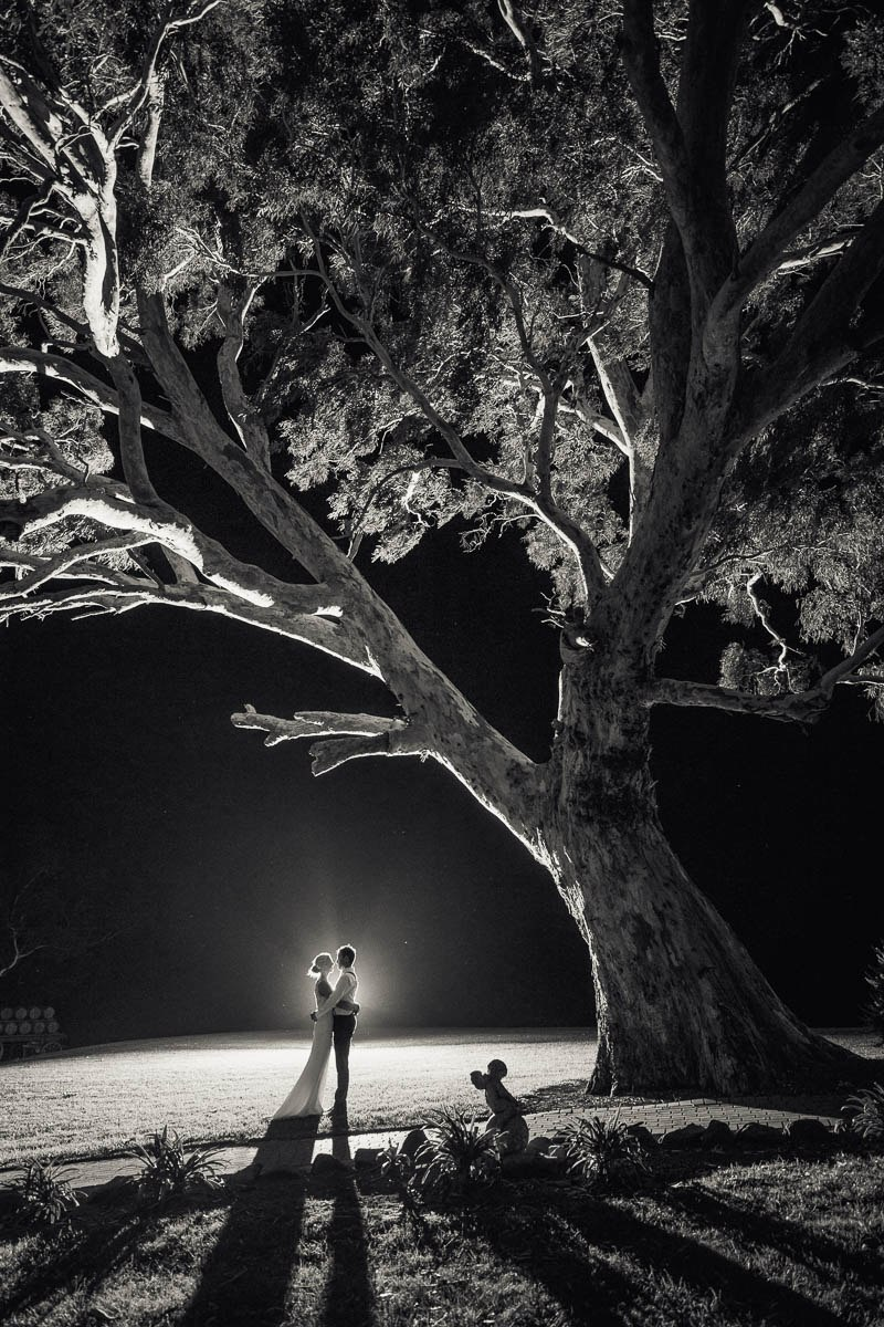 Bride and groom outside at night at Longview Vineyard