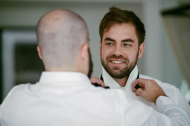 The groomsmen getting dressed for the wedding