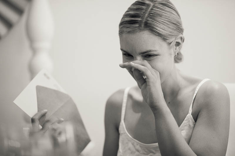 The bride crying after reading a letter given to her by the groom