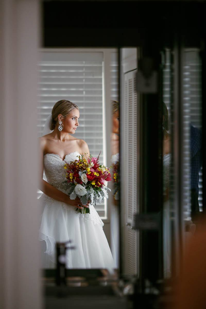 The bride looking out the window, ready to head to the ceremony at the Sheraton Mirage in Pt Douglas