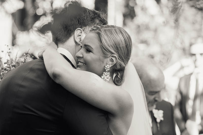 The bride hugging the groom when she reaches the top of the aisle