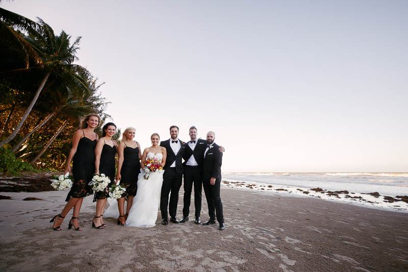Bridal party on the beach after the wedding ceremony in Pt Douglas