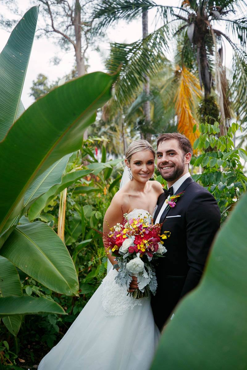 Bridal couple in the lush greenery at the Sheraton Mirage in Pt Douglas
