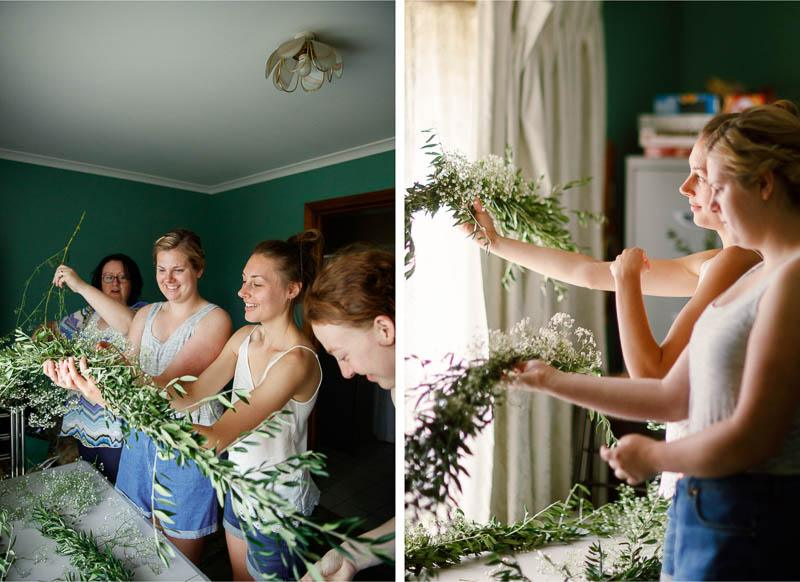 Bride and her bridesmaids preparing flowers for the wedding