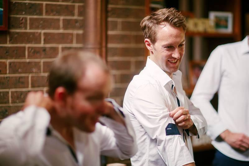 Groomsmen getting dressed before the wedding