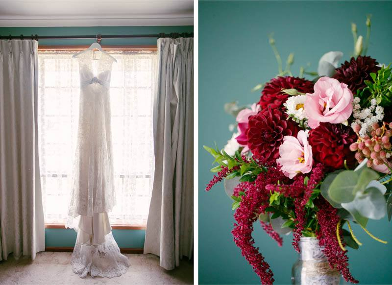 The wedding gown hanging in a window, and the bridal flowers