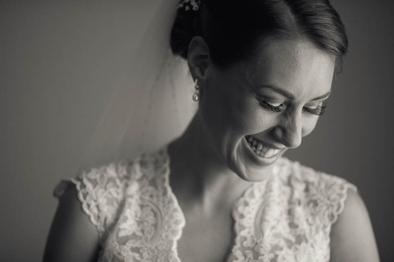 Laughing bride on her wedding day, about to get married at Serafino Wines