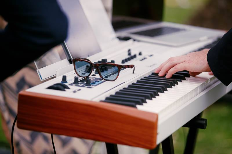 Detail of the keyboard player during the wedding ceremony