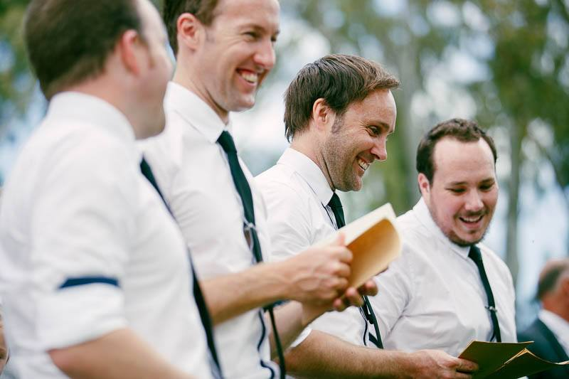 Groomsmen laughing during the wedding ceremony