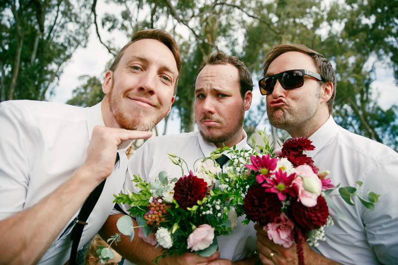 Boys being silly with flowers