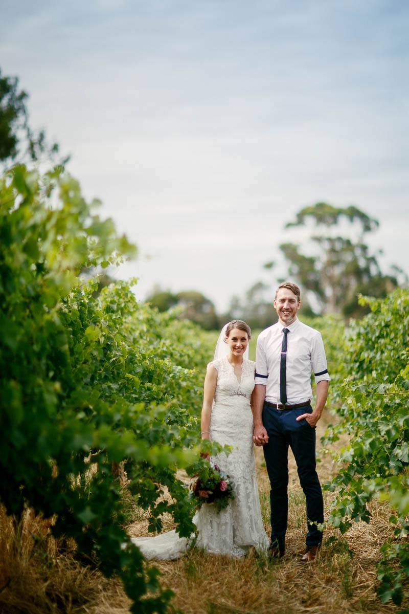 Bride and Groom in the vines after their wedding at Serafino Winery, McLaren Vale