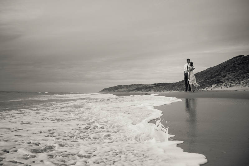 Bride and groom on the beach after their wedding at Maslins Beach