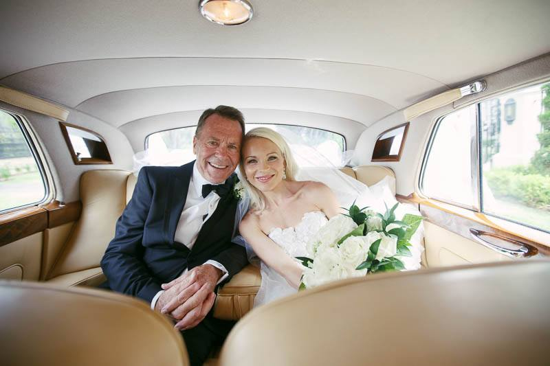 Bride and father in the car before leaving for Stangate House