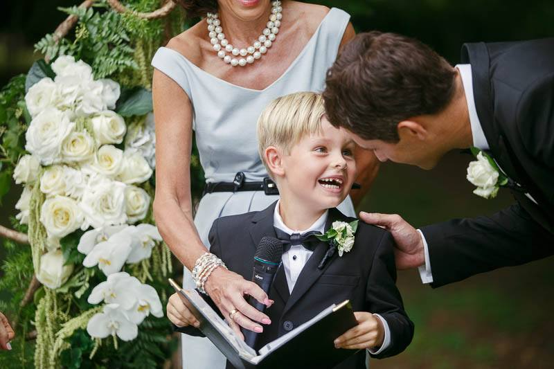 Pageboy laughing during the wedding ceremony