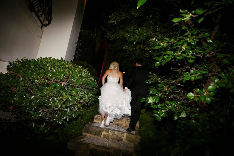 Bride and groom leaving their reception