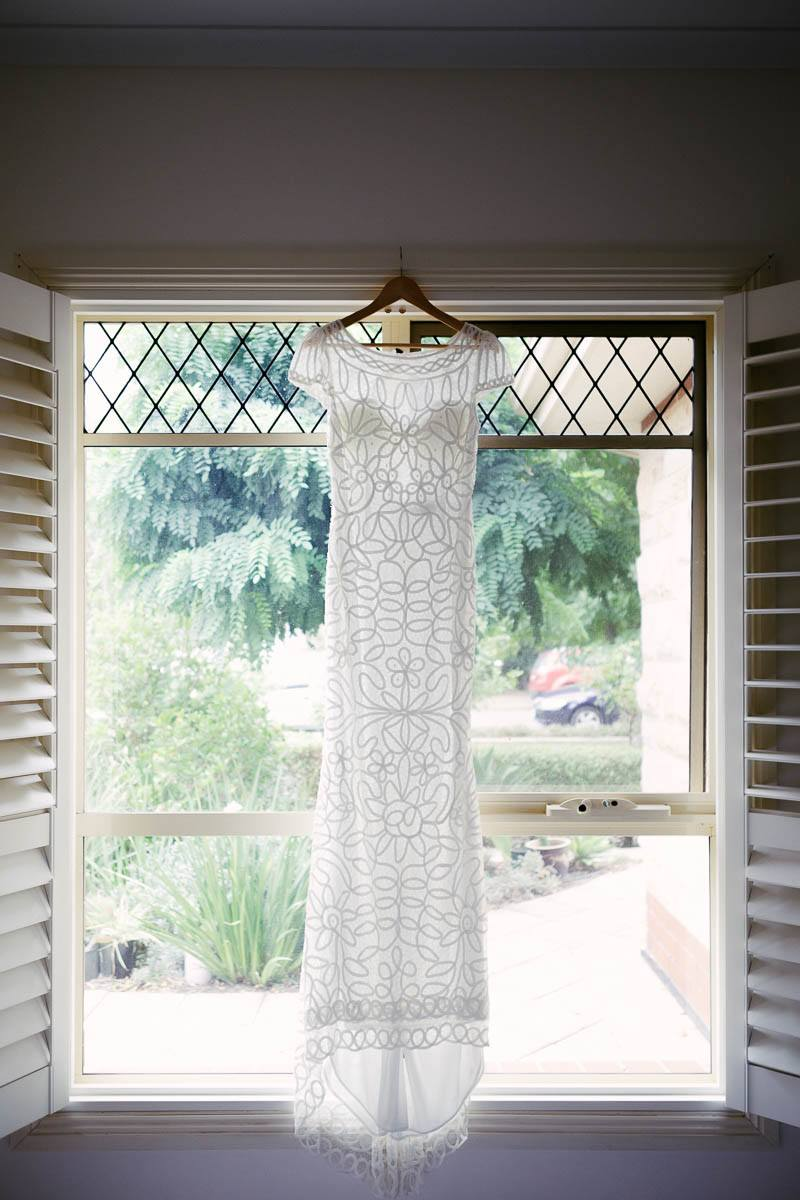 Wedding dress hanging in the window