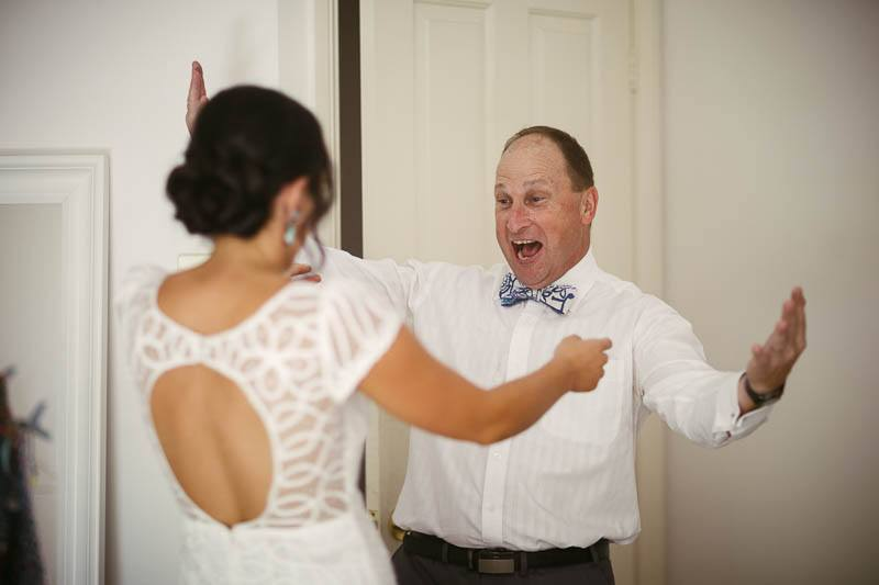 The brides father seeing his daughter for the first time in her wedding dress