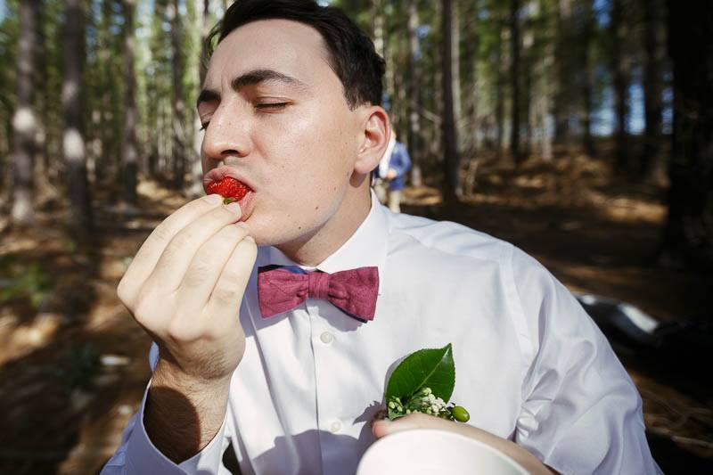 Groomsman eating strawberries