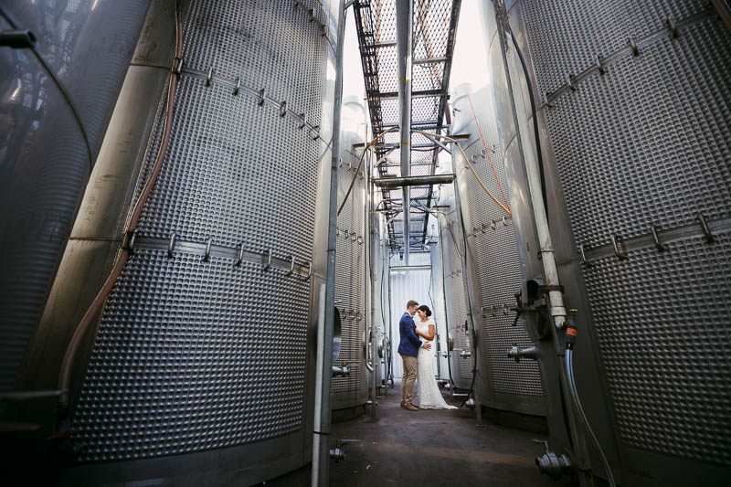 Bride and groom in Shottesbrooke Winery's winemaking equiptment