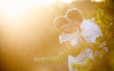 Bride and groom sneak out for sunset photos in the vines at The Currant Shed