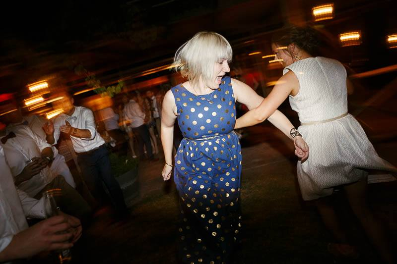 Guests spinning each other around on the dancefloor at The Currant Shed